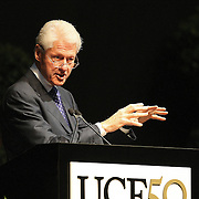 President Bill Clinton addresses graduates of UCF's College of Health and Public Affairs and the College of Medicine's Burnett School of Biomedical Sciences at the UCF Arena on Thursday, May 2, 2013 in Orlando, Florida. Clinton was also awarded an honorary degree that  recognizes his service as president and also his service as a humanitarian and international ambassador since he left office. This is his third visit to the UCF campus and he will be the second U.S. president to speak at a UCF graduation ceremony. President Richard M. Nixon addressed graduates in 1973.  (AP Photo/Alex Menendez)