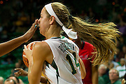 WACO, TX - DECEMBER 18: Makenzie Robertson #14 of the Baylor Bears controls the ball with a hand in her face against the Mississippi Lady Rebels on December 18 at the Ferrell Center in Waco, Texas.  (Photo by Cooper Neill) *** Local Caption *** Makenzie Robertson