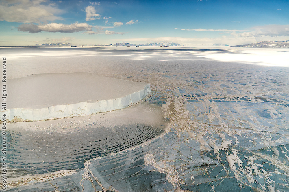 Grounded Iceberg, McMurdo Sound, Antarctica. To give a sense of scale, the vertical sides of this iceberg are 100 ft (30 M) high (I know because I landed on it in a helicopter).