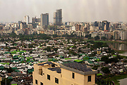 Karail slum area with the high rise development of Gulshan 2 in the distance on the 24th of September 2018 in Dhaka, Bangladesh. Approximately 200,000 people live in Karail slum both areas are on the banks Banani Lake. Karail slum is built publicly owned land and has been put up for development.