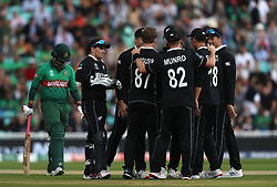 New Zealand's Lockie Ferguson celebrates taking the wicket of Bangladesh's Tamim Iqbal (left) during the ICC Cricket World Cup group stage match at The Oval, London.