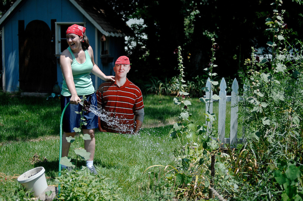 """Amanda Stapp and her husband, Jason, are helping a friend plant a rose bush in the garden. The newlyweds smile in the midday sunshine, wearing matching do-rags.<br /> <br /> This is typically a """"husband duty,"""" as Amanda calls it, but Jason quietly sits to the side as his wife clears the spot for the plant. She retrieves the tools from the garage, digs a hole, stakes the rose and waters the garden.<br /> <br /> When she accidentally sprays him with the hose, she picks him up, wipes him off and sets him down out of the way. Later, she takes a picture of him next to the bush so he'll know he was here.<br /> <br /> Jason, a captain in the Army National Guard, is serving a 400-day deployment in Kosovo. He left just two months after their wedding on Valentine's Day. His stand-in - a foam-core torso dubbed """"Flat Jason,"""" created with the help of www.flatdaddies.com - is a companion for Amanda on the adventures they would normally have together.<br /> <br /> She writes a blog - www.ayeartogetherapart.blogspot.com - so he can see what they are up to back in Columbia. She takes him to the farmers market, church on Sunday, bowling with friends, even the recent Willie Nelson concert at Jesse Hall.<br /> <br /> Inevitably there are stares and questions. """"Carrying him around really opens up the communication lines,"""" Amanda says. """"People will stop and talk, and they forget that we have military stationed all over the world, not just Iraq and Afghanistan.""""<br /> <br /> On Fridays, Amanda reaches for a red, white and blue paper chain hanging from her bedroom door. She rips off a link, knowing he is one week closer to being home. Only 42 more to go."""