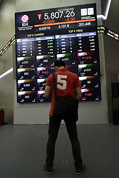 August 9, 2017 - Jakarta, DKI Jakarta, Indonesia - Visitors stand in front of electronic boards that display stock price movements, at the Indonesia Stock Exchange Building, Jakarta, Wednesday 8/9/2017. (Credit Image: © Kuncoro Widyo Rumpoko/Pacific Press via ZUMA Wire)