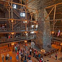 Tourists mingle inside historic Old Faithful Inn, Yellowstone National Park, Wyoming.
