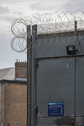 """© licensed to London News Pictures. London, UK 28/06/2012. HM Pentonville Prison, from where John Massey escaped. John Massey was sentenced to life imprisonment for murdering a man in a pub in Hackney in 1975. He escaped from Pentonville prison in Islington at around 6.30pm on Wednesday. Scotland Yard said he is considered """"potentially dangerous"""" and should not be approached.. Photo credit: Tolga Akmen/LNP"""