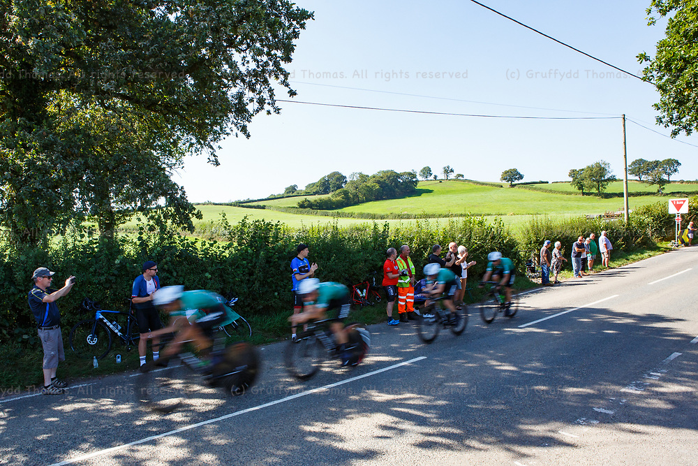 National Botanic Garden of Wales, Llanarthne, Wales, UK. Tuesday 7 September 2021.  Stage 3 of the Tour of Britain cycling race. Global 6 Cycling pass spectators on the side of the road.<br /> Credit: Gruffydd Thomas/Alamy