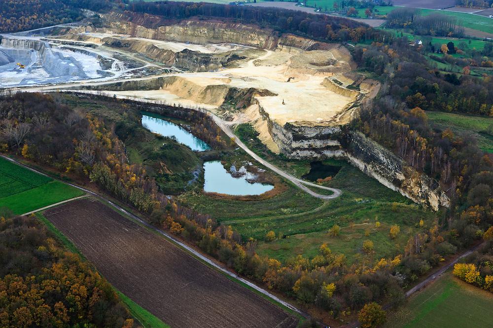 Nederland, Limburg, Maastricht, 07-03-2010; Sint-Pietersberg, mergelgroeve voor de winning van mergel (eigenlijk kalksteen) in dagbouw door cementfabriek ENCI. Wat er nog resteert van de St.Pietersberg is bescherm natuurgebied en bovengronds en ondergronds aangewezen als beschermd Habitatrichtlijngebied. Marl quarry for the extraction of marl (limestone actually) in surface mining by cement factory ENCI. What is left of the Sint-Pietersberg is designated as protected area, both on groundlevel and underground the habitat directives apply. luchtfoto (toeslag), aerial photo (additional fee required); foto/photo Siebe Swart