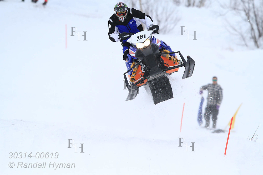 Snowmobile racing on a snowy motocross track is one of the highlights of the Sami Easter Festival in Kautokeino, Finnmark, Norway.