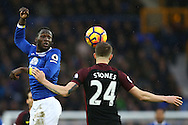 John Stones of Manchester City gets his head to the ball as Romelu Lukaku of Everton can only watch. Premier league match, Everton v Manchester City at Goodison Park in Liverpool, Merseyside on Sunday 15th January 2017.<br /> pic by Chris Stading, Andrew Orchard sports photography.