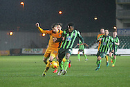 AFC Wimbledon striker Dominic Poleon (10) and Newport County defender & captain Scott Bennett (17) battle for possession during the EFL Trophy Southern Group B match between Newport County and AFC Wimbledon at Rodney Parade, Newport, Wales on 8 November 2016. Photo by Stuart Butcher.