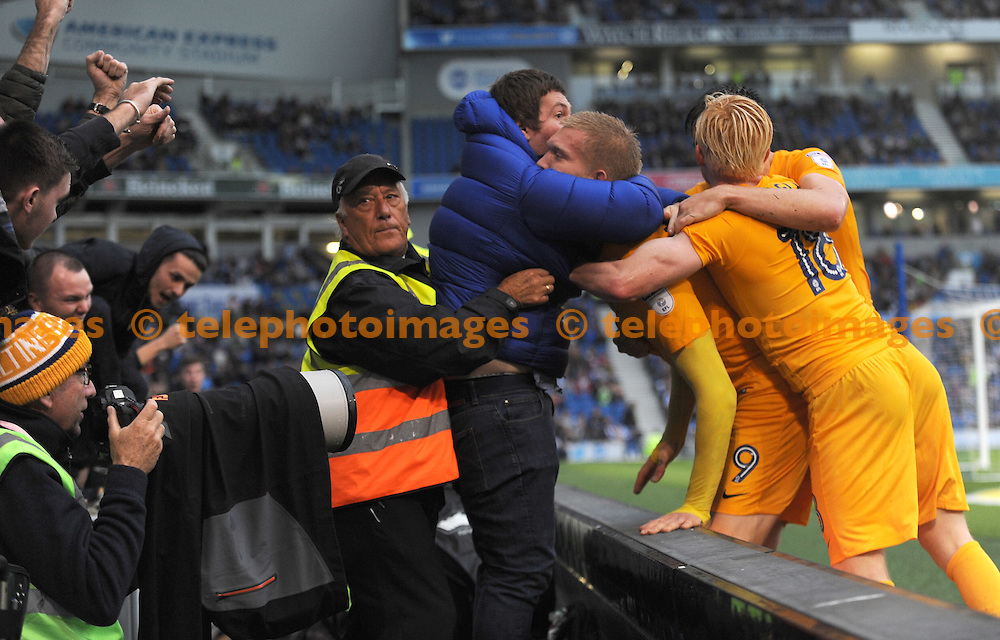 Simon Makienok of Preston  celebrates with the fans after he scores Preston's equaliser  during the Sky Bet Championship match between Brighton and Hove Albion and Preston North End at the American Express Community Stadium in Brighton and Hove. October 15, 2016.<br /> Liz  Finlayson / Telephoto Images<br /> +44 7967 642437