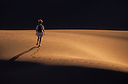 Image of a hiker at Death Valley National Park, California, America west coast, model released by Randy Wells