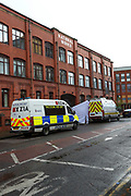Greater Manchester Police Tactical Aid Unit are at the scene in Old Trafford, Manchester on Thursday, April 29, 2021, following an allegation over an explosive device. (Photo/ Vudi Xhymshiti)