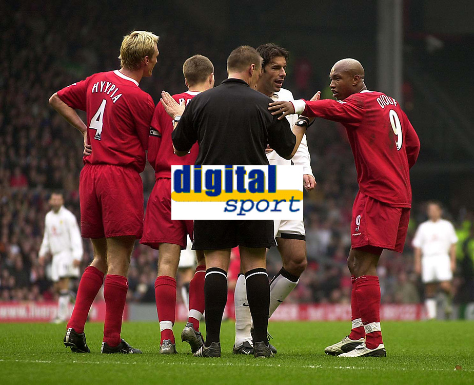 Photo. Glyn Thomas.<br /> Liverpool v Manchester United. Barclaycard Premiership.<br /> Anfield, Liverpool. 09/11/03.<br /> Manchester United's Ruud van Nistelrooy (second from R) is less than happy at being shown a yellow card and a confrontation ensues involving Liverpool's El-Hadji Diouf (R).