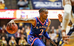 Jan 15, 2018; Morgantown, WV, USA; Kansas Jayhawks guard Lagerald Vick (2) attempts to make a move past a defender during the first half against the West Virginia Mountaineers at WVU Coliseum. Mandatory Credit: Ben Queen-USA TODAY Sports