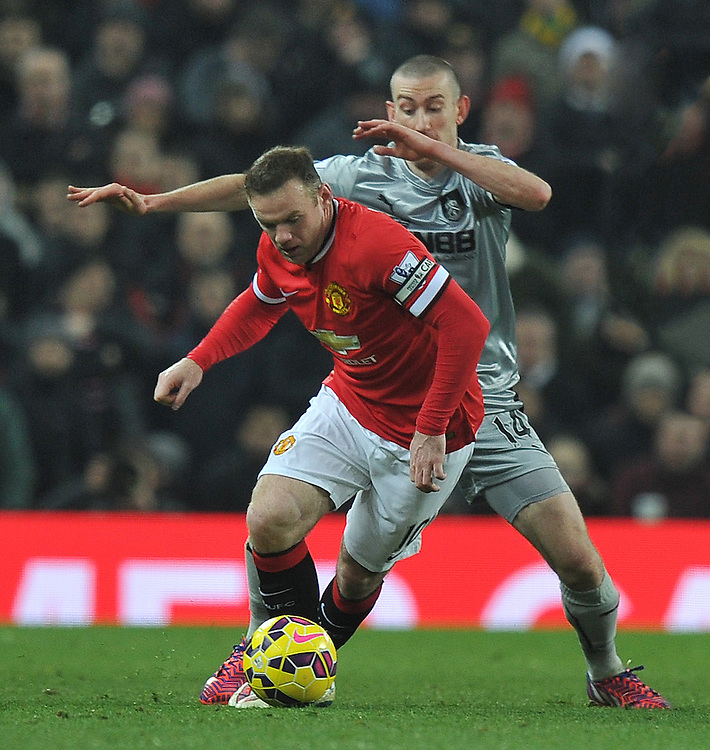 Burnley's David Jones battles with Manchester United's Wayne Rooney<br /> <br /> Photographer Dave Howarth/CameraSport<br /> <br /> Football - Barclays Premiership - Manchester United v Burnley - Wednesday 11th February 2015 - Old Trafford - Manchester<br /> <br /> © CameraSport - 43 Linden Ave. Countesthorpe. Leicester. England. LE8 5PG - Tel: +44 (0) 116 277 4147 - admin@camerasport.com - www.camerasport.com