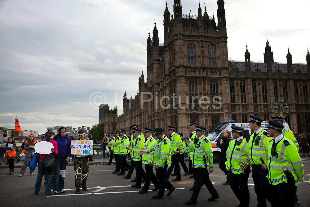 Police clearing the last few protestors from Westminster Bridge.<br /> The Health and Care Bill has been passed by Parliament and is due to go to the House of Lords. In protest against the bill which aim to deconstruct and privatise large parts of the NHS UK Uncut activists together with health workers and trade unionists blocked the Westminster Bridge from 1pm til 5.30pm.