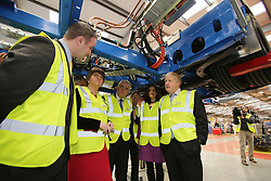 © Licensed to London News Pictures. 29/02/2016. Antrim, Northern Ireland, Mayor of London, Boris Johnson MP, stops under a chassis of a bus during a tour of Wrightbus plant in Antrim,  Northern Ireland. Boris was visiting businesses that are supported by investment from Transport for London. Photo credit : Paul McErlane/LNP