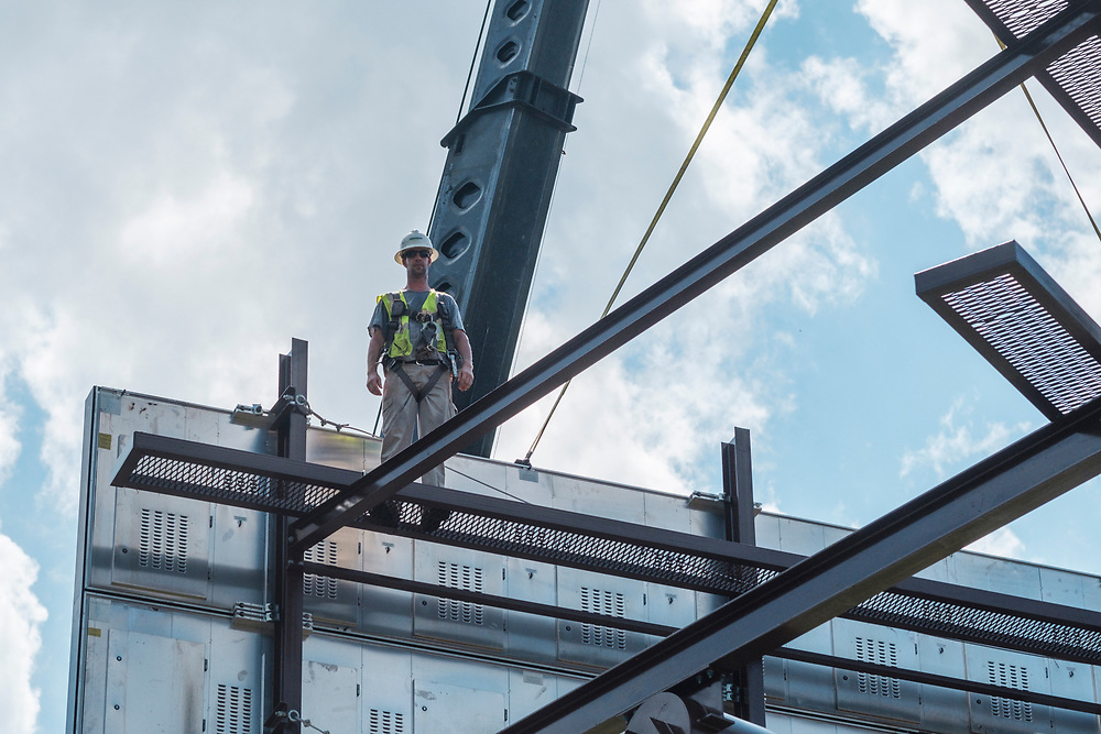 Rick Hand, crew leader, atop the billboard structure as technicians from Lamar Advertising install a digital billboard structure along Wards Road in Lynchburg, VA Wednesday, August 29, 2018. U.S. companies are investing in re-training efforts to fill a slew of open positions as a tight labor market and changing job requirements makes it hard to find qualified staffers.<br /> CREDIT: Justin Ide for The Wall Street Journal<br /> RETRAIN
