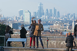 ©Licensed to London News Pictures 06/02/2020<br /> Greenwich, UK. A smiley selfie with a view across London. A bright sunny day with some blue sky in Greenwich Park, Greenwich, London. Photo credit: Grant Falvey/LNP
