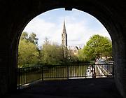 St John's RC church framed by bridge, Bath, Somerset, England, UK