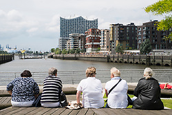 Senior women sitting at Marco-Polo-Terrassen part of modern Hafencity property development in Hamburg Germany