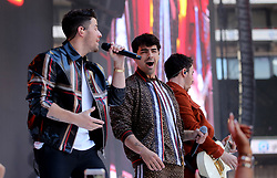 Nick Jonas (left) Joe Jonas and Kevin Jonas of Jonas Brothers on stage during Capital's Summertime Ball. The world's biggest stars perform live for 80,000 Capital listeners at Wembley Stadium at the UK's biggest summer party.