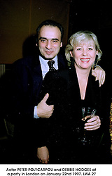 Actor PETER POLYCARPOU and DEBBIE HODGES at a party in London on January 22nd 1997.LWA 27