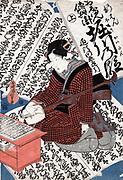 Scene of Oshun Denbei Horikawa: Horikawa (1079-1107) Emperor of Japan 1087-1107 shown playing a shamisen, surrounded by large sheets of text. Utagawa Toyokuni III (1786-1865) also called Utagawa Kunisada.  Music Instrument