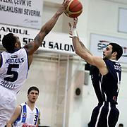 Anadolu Efes's Dogus Balbay (R) during their Turkish Basketball league derby match  Fenerbahce Ulker between Anadolu Efes at Caferaga Sports Hall in Istanbul, Turkey, Saturday 01, 2012. Photo by TURKPIX