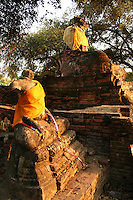 Headless Buddhas at Wat Phra Si Sanphet - built by King Boromatrailokanat in 1448, it was one of the grandest temples in the ancient capital and it is still one of the best preserved in Ayutthya. The temple took its name from a large standing Buddha image covered with more than 150 kilograms of gold though it was smashed to pieces when the Burmese sacked the city.  Remaining Buddha relics are usually adorned with flowers and saffron robes.