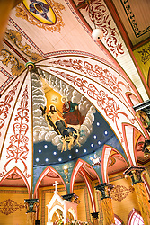 Zarcero, Alajuela, Central Highlands:  Magnificent painted ceiling of the apse of the Iglesia de San Rafael, known as the pink and white church.  It was built in 1895 with an exterior of metal siding and a painted interior of faux bois and marble.  It is one of the most beautiful painted churches in the world.