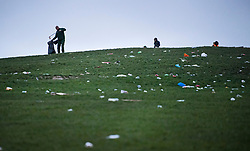 © Licensed to London News Pictures. 05/04/2021. London, UK. A council worker cleans up litter strewn across the hillside of Primrose Hill in north London, the morning after revellers took to the picturesque location to enjoy the warm spring weather. A relaxation of some lockdown restrictions has gathered larger crowds in many outdoor spaces. Photo credit: Ben Cawthra/LNP