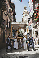 The route of the Camino de Santiago follows Calle Mayor through the town center of Puente la Reina, Spain. On  this particular Sunday afternoon, at 12:30 p.m., so did a church procession. (June 3, 2018)<br />