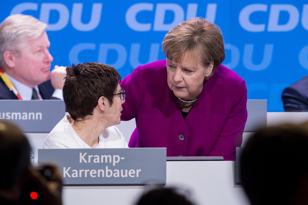 26 FEB 2018, BERLIN/GERMANY:<br /> Annegret Kramp-Karrenbauer (L), CDU, desig. Generalsekraetrin, und Angela Merkel (R), CDU, Bundeskanzlerin, im Gespraech, CDU Bundesparteitag, Station Berlin<br /> IMAGE: 20180226-01-102<br /> KEYWORDS: Party Congress, Parteitag, Gespräch