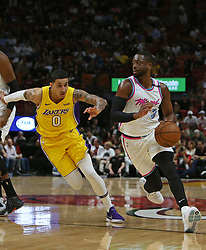 March 1, 2018 - Miami, FL, USA - The Miami Heat's Dwyane Wade, right, drives against the Los Angeles Lakers' Kyle Kuzma during the second quarter at the AmericanAirlines Arena in Miami on Thursday, March 1, 2018. The Lakers won, 131-113. (Credit Image: © David Santiago/TNS via ZUMA Wire)