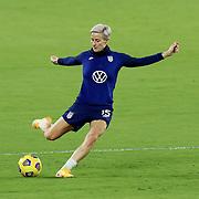 ORLANDO, FL - JANUARY 22:  Megan Rapinoe #15 of United States kicks the ball against Colombia at Exploria Stadium on January 22, 2021 in Orlando, Florida. (Photo by Alex Menendez/Getty Images) *** Local Caption *** Megan Rapinoe