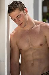 tired shirtless muscular man outdoors