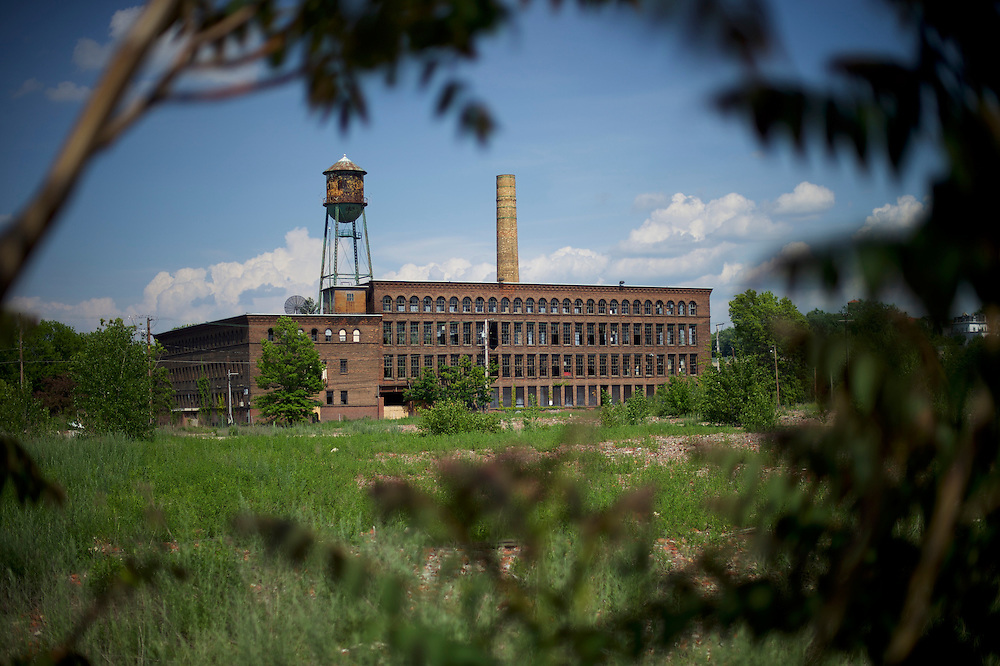 WILKES-BARRE- May 27, 2016.  An out of business factory framed through trees in Wilkes-Barre, PA, a city of 41,000 in central Pennsylvania.  Wilkes-Barre is the county seat of Luzerne County, in which 77.4% of Republicans voted for Donald Trump.   CREDIT: Mark Makela for The New York Times  in Wilkes-Barre, PA, a city of 41,000 in central Pennsylvania.  Wilkes-Barre is the county seat of Luzerne County, in which 77.4% of Republicans voted for Donald Trump.