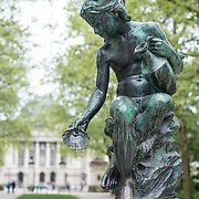 Statue of a girl in Brussels Park across from the Royal Palace of Brussels in central Brussels, Belgium.