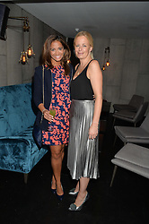 Left to right, KATY WICKREMESINGHE and ASTRID HARBORD at a dinner to celebrate London Fashion Week SS 2015 and the opening of Ramusake at 92 Old Brompton Road, London on 15th September 2014.