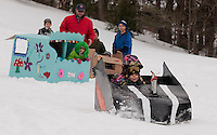 """Ty and Caleb Bartlett blast out of the start with their """"boys will be boys"""" Speed Racer during Gilford Parks and Recreation cardboard sled derby at the Gilford Outing Club Wednesday morning.   (Karen Bobotas/for the Laconia Daily Sun)"""