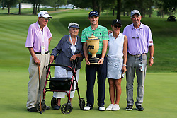 August 5, 2018 - Akron, Ohio, United States - (L-R) Grandfather Paul Thomas, grandmother Phyllis Thomas, Justin Thomas, mother Jani Thomas and father Mike Thomas with the trophy after winning the WGC-Bridgestone Invitational at Firestone Country Club. (Credit Image: © Debby Wong via ZUMA Wire)