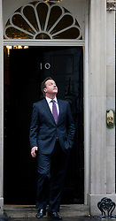 © licensed to London News Pictures. London, UK 18/04/2012. Prime Minister David Cameron waiting outside No 10 before meeting with Portuguese Prime Minister Pedro Passos Coelho at 10 Downing Street this afternoon. Photo credit: Tolga Akmen/LNP