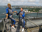 31.JAN.2011<br /> Did she say yes? David Hasselhoff proposes to girlfriend Hayley Roberts on top of the Sydney Harbour Bridge<br /> <br /> He may have already popped the question twice to girlfriend Hayley Roberts, but her snubs didn't put David Hasselhoff off asking the pretty blonde again - this time on top of the Sydney Harbour Bridge.<br /> And it seems the Baywatch actor's toygirl may have said yes, judging by the picture the Baywatch actor posted on his Twitter page.<br /> Hasselhoff was seen on bended knee as he asked Hayley, 32, to marry him, before kissing the Welsh beauty in a passionate embrace.<br /> The 59-year-old actor captioned his second picture with the words: 'What do you think she said?!'<br /> And while Hayley didn't confirm the news on her Twitter page, she did post a crypitc: ':-)))))) xxxxxxxxxxxx'<br /> A representative for Hasselhoff has yet to confirm the news.<br /> <br /> Hasselhoff previously proposed to his girlfriend twice last year, as the pair holidayed in Cape Town, South Africa, but Hayley said no.<br /> <br /> The proposals came after Hasselhoff, who has two daughters from a previous marriage, hinted that he is ready to get married for a third time.<br /> He admitted: 'I believe you should only marry people if you can't live without them.<br /> 'If you can live with them, live with them. Right now with Hayley things are getting better in every way.<br /> 'I've thought about the age gap and it doesn't bother me or Hayley I hope.'<br /> The couple have been together for nearly a year after meeting when Hayley asked for his autograph at the Britain's Got Talent auditions in Cardiff, Wales.<br /> If Hasselhoff is engaged it will be the third marriage for the actor. <br /> He was married to Catherine Hickland from 1984 to 1989. <br /> He then married Pamela Bach on December 9, 1989, and the couple had two daughters - Taylor and Hayley. <br /> Hasselhoff filed for divorce from Bach in January 2006 citing irreconcilable differences.<br 