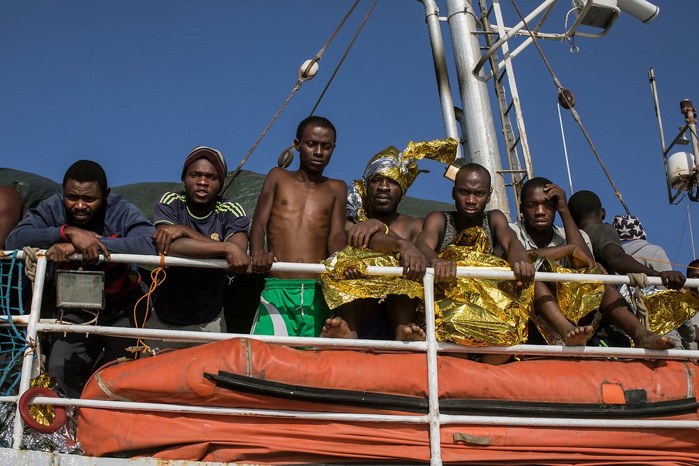 June 29th, 2017, Central Mediterranean. Speedboats approaching Sea Eye vessel for the evacuation of Samuel Osei, a 36-year-old man from Ghana severely sick after being rescued in the sea. NGO Proactiva Open Arms in their 20th rescue mission in the Central Mediterranean Sea on board of Golfo Azzurro vessel (photo Edu Bayer)