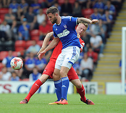 Leyton Orient's Nathan Clarke tussles for the ball with Ipswich Town's Daryl Murphy- photo mandatory by-line David Purday JMP- Tel: Mobile 07966 386802 02/08/14 - Leyton Orient v Ipswich Town - SPORT - FOOTBALL - Pre season - London -  Matchroom Stadium