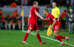 Wayne Rooney of England and his substitute Joe Cole of England during the 2010 FIFA World Cup South Africa Group C Third Round match between Slovenia and England on June 23, 2010 at Nelson Mandela Bay Stadium, Port Elizabeth, South Africa. England defeated Slovenia 1-0 and qualified for the next round, Slovenia not. (Photo by Vid Ponikvar / Sportida)