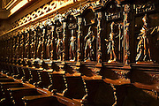 Carved cedar statues above wooden stalls surround the chapels of the Monasterio de San Francisco in Lima, Peru.