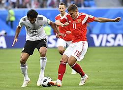 SAINT PETERSBURG, June 19, 2018  Marwan Mohsen (L) of Egypt vies with Roman Zobnin of Russia during a Group A match between Russia and Egypt at the 2018 FIFA World Cup in Saint Petersburg, Russia, June 19, 2018. (Credit Image: © Chen Yichen/Xinhua via ZUMA Wire)